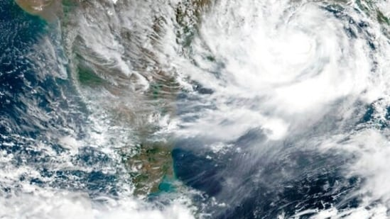 Tens of thousands of people are being evacuated from low-lying areas of two Indian states to escape the strong cyclone barreling toward the eastern coast. (AP)