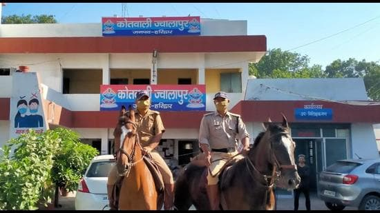 Mounted horse squad patrolling at markets during Covid-19 curfew on Wednesday in Haridwar. (HT photo)