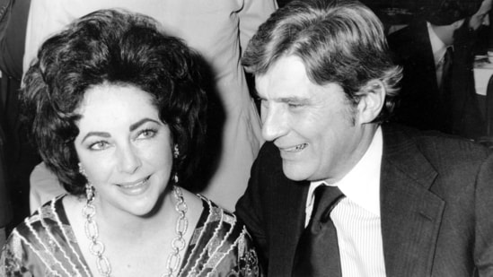John Warner and his then-wife, actress Elizabeth Taylor, at the 42nd New York Film Critics Circle Awards dinner.(AP / File Photo)