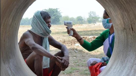 A Jharkhand government health worker conducts thermal screening of a villager at Chaite village in Namkum block of Ranchi earlier this month. (File photo)