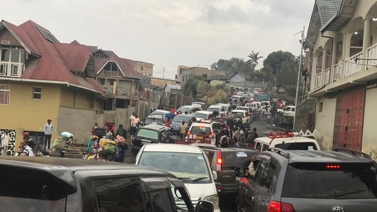 Residents were advised to carry very little, that they could not return to their homes until advised by authorities and that vehicles will be provided to help with the evacuation. In picture - Traffic clogs a main road as residents try to flee Goma, Congo.(AP)