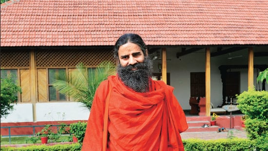 Yoga guru Ramdev has been in the middle of a controversy over his video against allopathic medicines that has prompted the IMA to demand that a sedition case be registered against him (Mint File Photo/Pradeep Gaur)