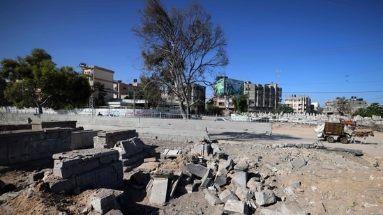 """""""If found to be indiscriminate and disproportionate, such attacks might constitute war crimes,"""" Michelle Bachelet said. In picture - Damage around tombs in the old Shujaiya cemetery in Gaza City.(AFP)"""