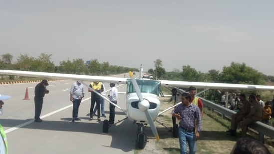 The private trainer aircraft parked on Yamuna Expressway within limits of Naujheel police station of Mathura district