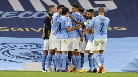 Manchester City players react after scoring. (Getty Images)