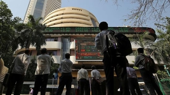 People look at a screen displaying the Sensex results on the facade of the Bombay Stock Exchange (BSE) building in Mumbai(Reuters file photo)