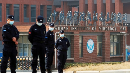 Security personnel keep watch outside the Wuhan Institute of Virology. (File Photo)(REUTERS)