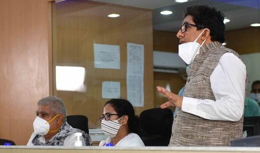 Chief minister of West Bengal Mamata Banerjee with Governor Jagdeep Dhankhar and state secretary Alapan Bandopadhyay (R) at a control room for Cyclone Yaas at State Secretariat building Nabanna in Kolkata. (HT Photo)