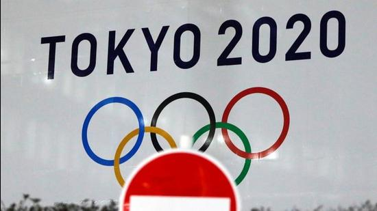 The logo of Tokyo 2020 Olympic Games, that have been postponed to 2021, is seen through a traffic sign at Tokyo Metropolitan Government Office building in Tokyo, Japan. (File photo)