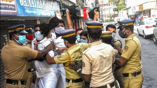 Police attempt to detain Youth Congress workers during a protest against recent rules and regulations brought in by the administrator in Lakshadweep, in Kochi on Thursday, May 27. (PTI)