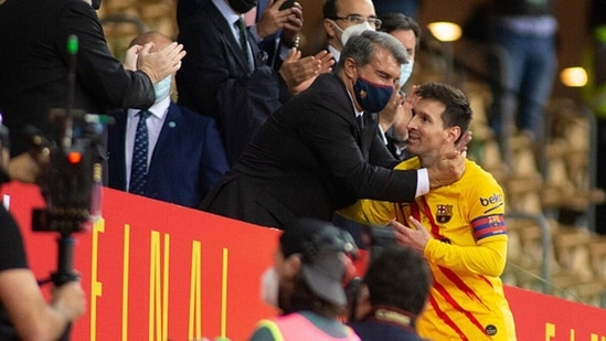 President of Barcelona Joan Laporta and Lionel Messi of Barcelona hug. (Getty Images)