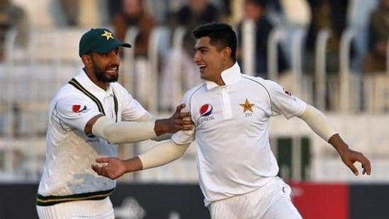Pakistan pacer Naseem Shah, right, celebrates with teammate Shan Masood(AP)