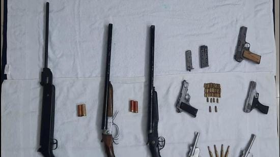 Eight weapons, including two countrymade 32 bore pistols and a 30 bore pistol, were recovered from two of the accused. (HT Photo)