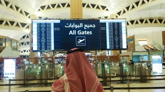 A Saudi man checks the flight timings at the King Khalid International Airport authorities lifted the travel ban on its citizens.(Reuters / File)