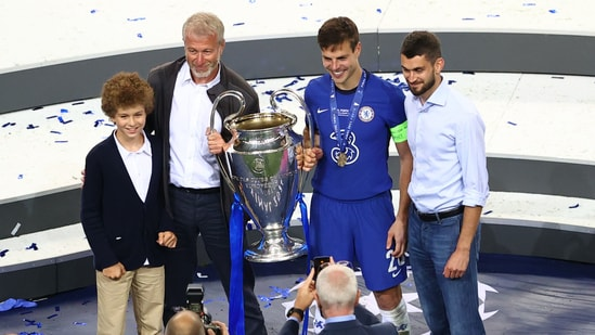 Chelsea's Cesar Azpilicueta celebrates with the trophy and owner Roman Abramovich after winning the Champions League.(Pool via REUTERS)