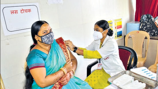 A health staff vaccinates a beneficiary at Talera Hospital, Chinchwad , on Friday. As Covishield doses were available on Friday, PCMC conducted vaccinations at 65 centres. (HT PHOTO)