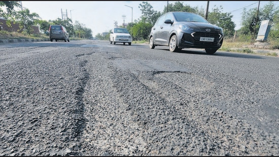 A dilapidated road in Sector 51, Chandigarh. The civic body manages a road network of around 1,400 kilometres, among which the V-6 roads (access roads to houses) are in the worst condition, as per city residents. (Ravi Kumar/HT)