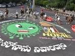 Hyderabad artist raises awareness about Covid-19 lockdown with graffiti on road(Twitter/mounika_THI)