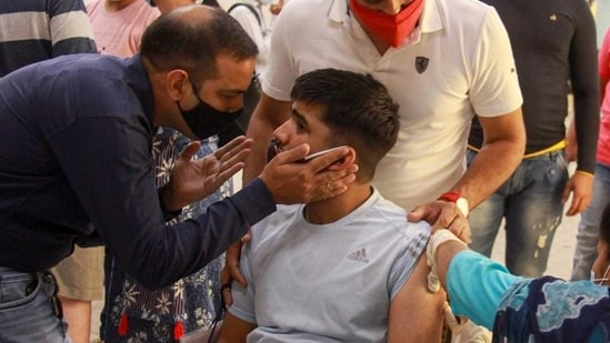 A beneficiary receives a dose of the Covid-19 vaccine during a vaccination drive for specially-abled in Gurugram. (PTI)