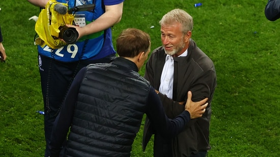 Chelsea manager Thomas Tuchel celebrates with owner Roman Abramovich after winning the Champions League.(Pool via REUTERS)