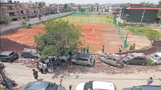 Seven cars were damaged after the boundary wall of a school in Sector 9, Panchkula, collapsed following a squall on Saturday night. (Sant Arora/HT)