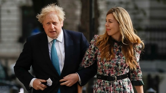 British Prime Minister Boris Johnson arrives at a polling station with his partner Carrie Symonds to cast his vote in local council elections in London. (AP file photo)