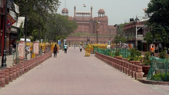 Chandni Chowk area in front of the Red Fort wears a deserted look during the Covid-induced lockdown, in New Delhi(PTI Photo)