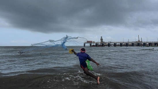 A fisherman does fishing ahead of southwest monsoon at a seaside in Kochi. (PTI Photo)