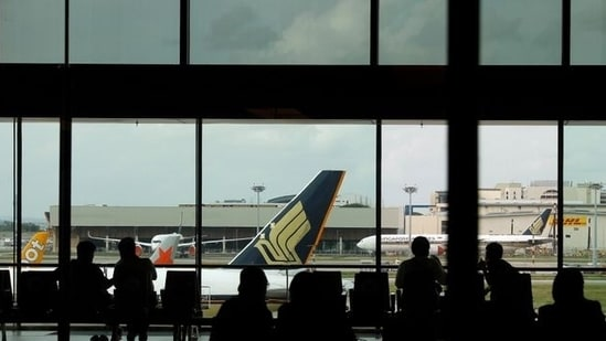 People look at a Singapore Airlines plane, amid the spread of the coronavirus disease (Covid-19), at a viewing gallery of the Changi Airport in Singapore October 12, 2020 (Reuters).