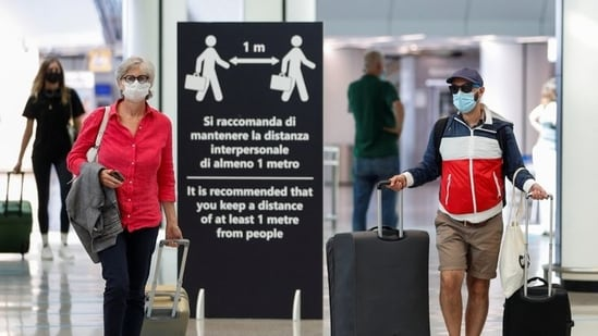 About half of EU adults have received a first vaccine dose. In picture - Passengers at Fiumicino Airport in Rome, Italy.(Reuters | Representational image)