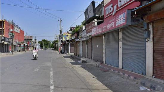 Model Town market in Ludhiana, Punjab, wears a deserted look during the weekend lockdown on Sunday, May 30. (by (Harsimar Pal Singh/HT photo)