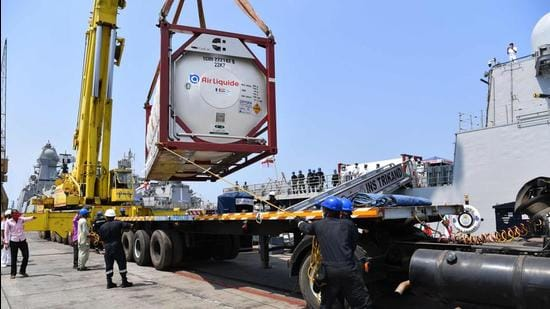 Navy personnel unload Liquid Medical Oxygen tanks supplied by French company Air Liquide as part of France's assistance efforts toward Covid-19 relief to India after arriving from Qatar, at the naval dockyard in Mumbai on May 10. (File photo)