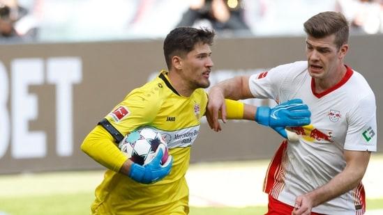 Stuttgart's Swiss goalkeeper Gregory Kobel (L) and Leipzig's Norwegian forward Alexander Sorloth.(AFP)