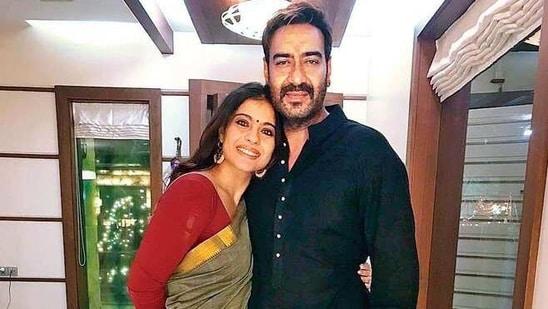 Kajol and Ajay Devgn pose together.(Twitter)