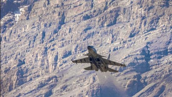 An Indian Air Force fighter jet flies in the backdrop of Himalayan mountain ranges, amid de-escalation efforts by India and China in eastern Ladakh, in Leh. (PTI)