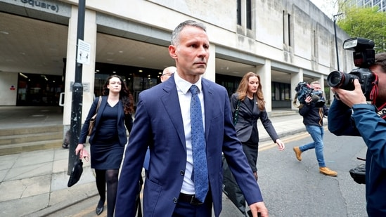 Former Manchester United footballer Ryan Giggs leaves Manchester Crown Court where he appeared on charges of assaulting two women, in Manchester.(AP)