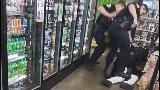A video showed officers of the Huntsville Police Department assaulting a man at the local store.(Screenshot - Facebook live video by Bruce Turner)