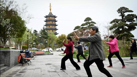 A file photo of people practising tai chi along a street in Rugao, in China's Jiangsu province. (AFP)