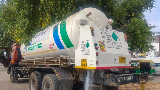 Oxygen-filled tankers stand parked at the Old Faridabad Railway Station, in Faridabad. (PTI)