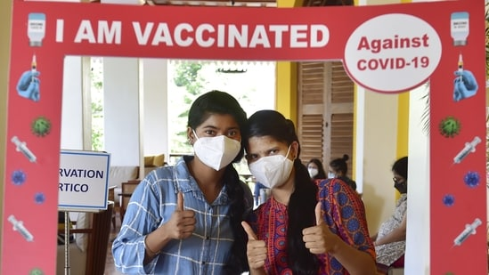 Beneficiaries pose for a photo after receiving shot of Covid-19 vaccine in Bengaluru, on Tuesday.(PTI Photo)
