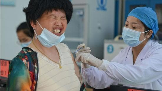 A resident receives coronavirus vaccine in Linquan county, Fuyang city, in China's eastern Anhui province. (AFP)