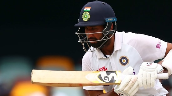 India's batsman Cheteshwar Pujara plays a shot on day five of the fourth cricket Test match between Australia and India at The Gabba in Brisbane. (AFP)