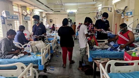 Gandhi Hospital doctors attend the Covid-19 patient in Hyderabad on Monday. (ANI Photo)