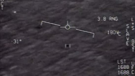 """The US Department of Defense shows part of an unclassified video taken by Navy pilots that have circulated for years showing interactions with """"unidentified aerial phenomena"""".(AFP)"""