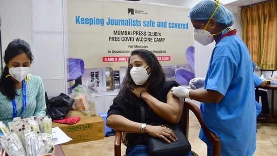 Mumbai: A health worker administers a dose of the COVID-19 vaccine to a journalist, during a special vaccination drive for journalists and their family members, organised by Mumbai Press Club with Surya Hospital, in Mumbai, on Friday, June 4, 2021. (PTI)