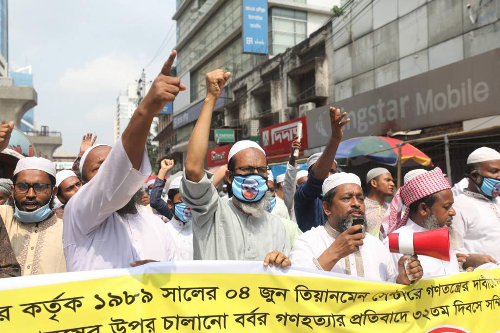 People in Bangladesh holding demonstrations against China's human rights violations.