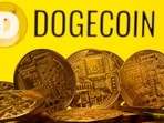 Cryptocurrency representations are seen in front of the Dogecoin logo in this illustration picture taken on April 20, 2021. (Reuters)