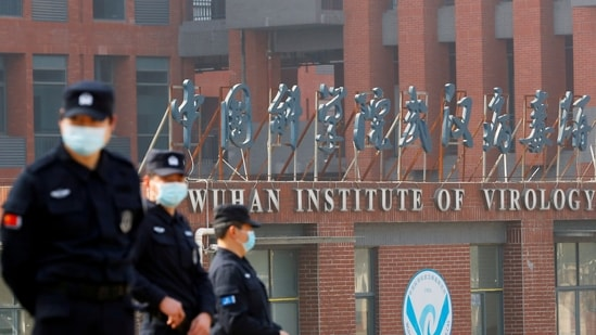 Security personnel keep watch outside the Wuhan Institute of Virology.(Reuters)