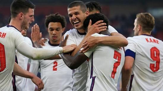 England's Bukayo Saka is embraced by England's Conor Coady.(AP)