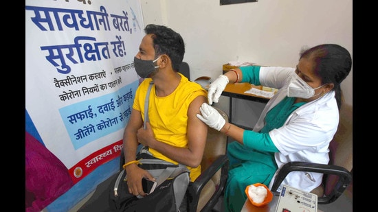 A man being inoculated against Covid-19 at Government Multi-Specialty Hospital, Sector 16, in Chandigarh on Saturday. (Ravi Kumar/HT)